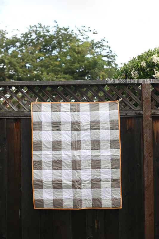 plaid quilt, blanket, and baby toy gifts